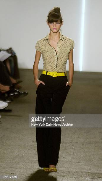 A model wears an ivory georgette with black polkadot top over black cotton twill pants during the showing of the new DKNY collection as part of...