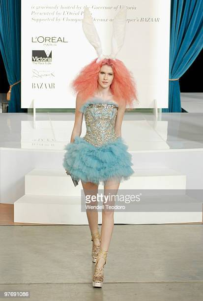 A model wears an outfit by Akira during the Opening Night Party for the 2010 L'Oreal Melbourne Fashion Festival at Government House on March 14 2010...