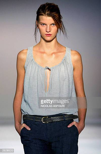 A model wears an outfit by designer Nicole Farhi during the 2004 Spring/Summer collection show in London as part of London Fashion Week 23 September...
