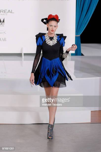 A model wears an outfit by Dion Lee during the Opening Night Party for the 2010 L'Oreal Melbourne Fashion Festival at Government House on March 14...