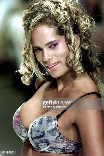 A model wears an outfit by Palmarosa during the XV Colombiamoda fashion show 19 August 2004 in Medellin Colombia AFP PHOTO/Fredy AMARILES