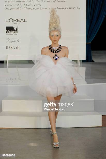A model wears an outfit by Romance Was Born during the Opening Night Party for the 2010 L'Oreal Melbourne Fashion Festival at Government House on...