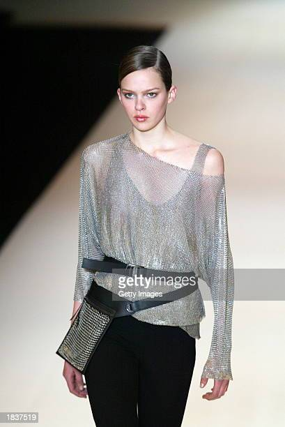 A model wears an outfit created by Paco Rabanne during their Fall/Winter 2004 readytowear collection March 9 2003 in Paris France