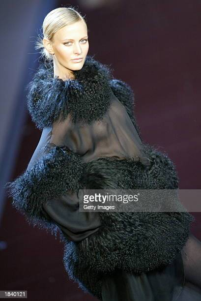 A model wears an outfit created by Valentino during the Fall/Winter 2004 readytowear collection March 1O 2003 in Paris France