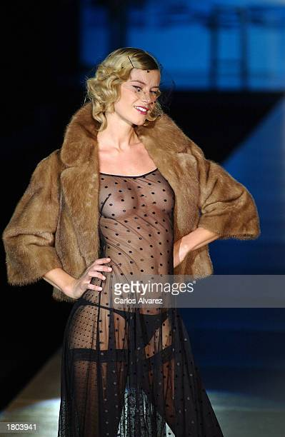 A model wears an outfit from the Andres Sarda Fall/Winter 2003 lingerie collection during the Cibeles Fashion Week show February 19 2003 in Madrid...