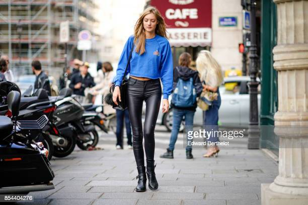 A model wears blue pull over black pants outside Anrealage during Paris Fashion Week Womenswear Spring/Summer 2018 on September 26 2017 in Paris...