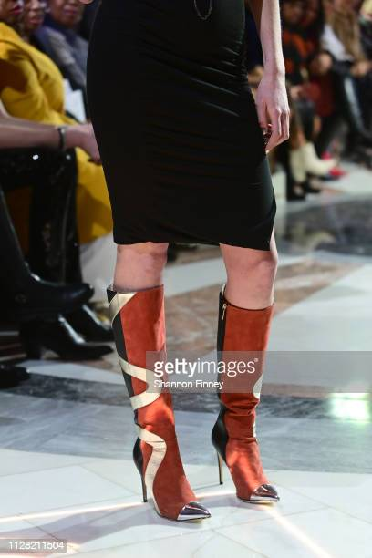 A model wears boots by shoe designer Tori Soudan at the District of Fashion Fall/Winter 2019 Runway Show on February 07 2019 at the National Museum...