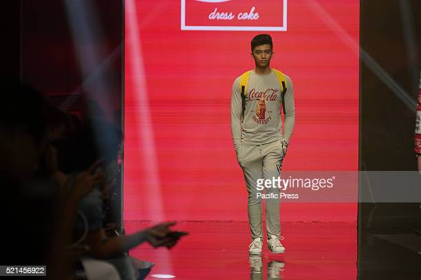 Model wears clothes inspired by CocaCola during the Manila Fashion Festival 2016