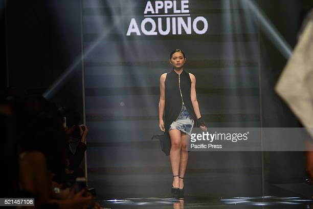 A model wears clothing designed by Apple Aquino during the Manila Fashion Festival 2016