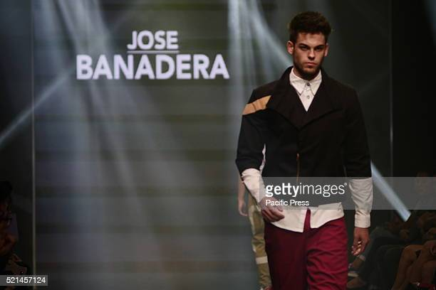 A model wears clothing designed by Jose Banadera during the Manila Fashion Festival 2016