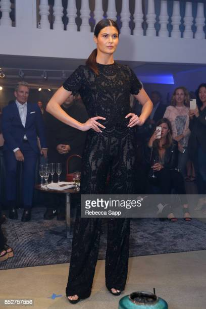 Model wears design by Laura Basci at Laura Basci and de Sede Los Angeles Showroom Opening on September 23 2017 in Los Angeles California