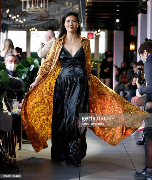 Model wears designs by Essere Vegano during the fashion show on March 25, 2021 in New York City.