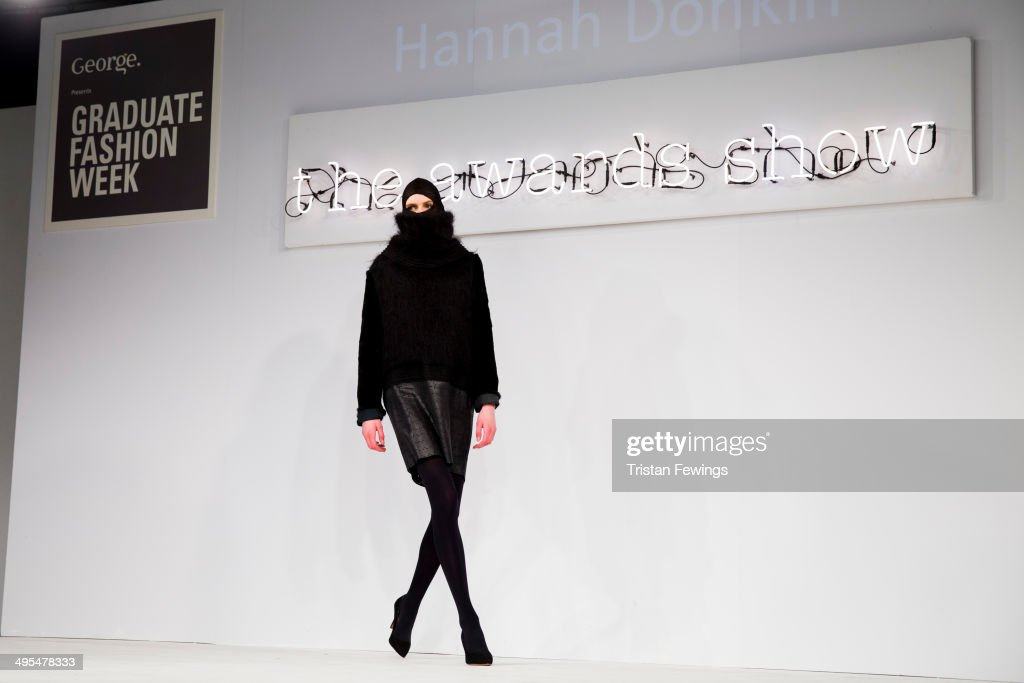 A model wears designs by Hannah Donkin on the runway during the GFW Awards Show during day 4 of Graduate Fashion Week 2014 at The Old Truman Brewery on June 3, 2014 in London, England.