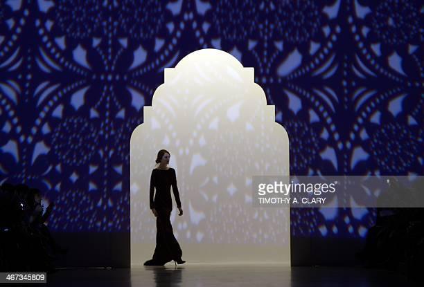A model wears designs by Tadashi Shoji during the MercedesBenz Fashion Week Fall/Winter 2014 shows February 6 2014 in New York City AFP PHOTO/Timothy...