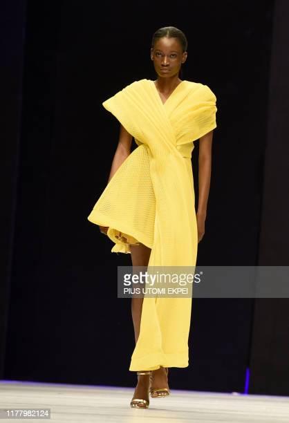 Model wears DZYN creations during the yearly Lagos Fashion Week in Lagos, on October 24, 2019. - Lagos Fashion Week is a fashion platform bringing...