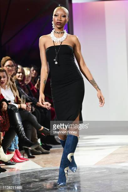 A model wears footwear by Tori Soudan and jewelry by LoveSoulStyle at the District of Fashion Fall/Winter 2019 Runway Show on February 07 2019 at the...