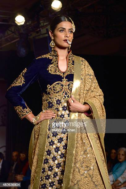 A model wears Indian designer Reynu Taandon's showstopper for her Persian inspired couture line on day four of the Fashion Design Council of India's...