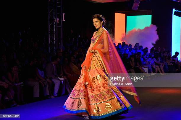 A model wears Kolkatabased designer Debarun in his debut couture collection a modern interpretation of Bollywood styles though the decades on day...
