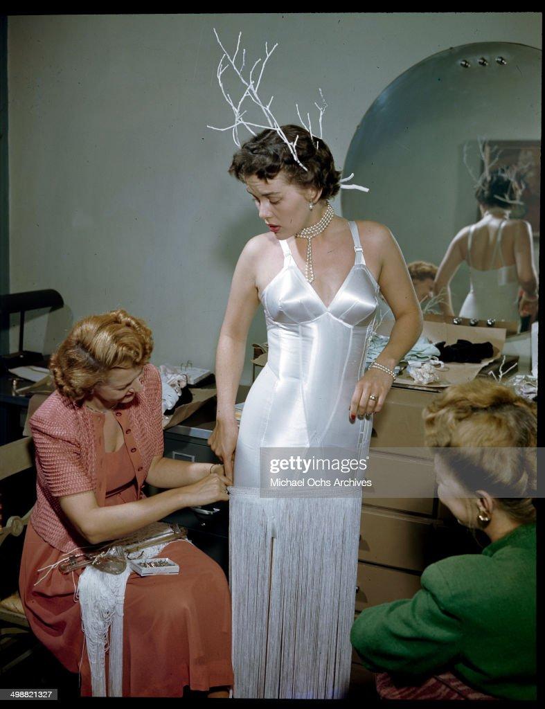 A model wears lingerie as the designer adds fringe in New York in September 27,1949.