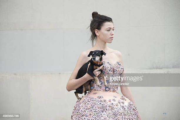 Model wears Marina Hoermanseder with Peanut the dog on day 6 during Paris Fashion Week Spring/Summer 2016/17 on October 4 2015 in Paris France