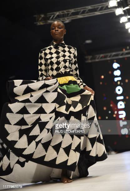 Model wears Studio 189 creations during the yearly Lagos Fashion Week in Lagos, on October 24, 2019. - Lagos Fashion Week is a fashion platform...