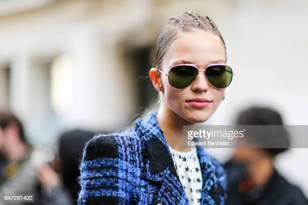 A model wears sunglasses outside the Balmain show during Paris Fashion Week Womenswear Fall/Winter 2017/2018 on March 2 2017 in Paris France