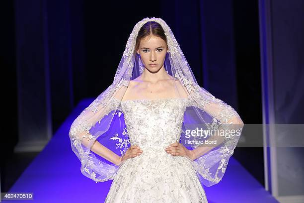 A model wears the bridal gown closing the Ralph Russo show as part of Paris Fashion Week Haute Couture Spring/Summer 2015 on January 29 2015 in Paris...