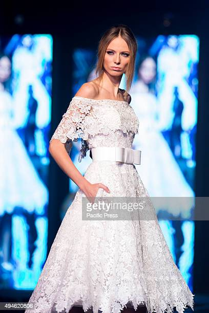 A model wears the bridal gown designed by Pinella Passaro during the 'Tuttosposi 2015' at Mostra d'Oltremare