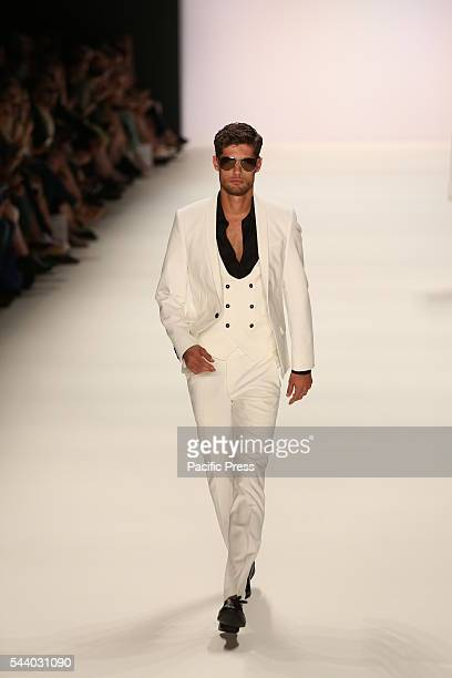 Model wears the collection of Dimitri during the catwalk in the Erika Hess Ice Stadium in Berlin-Wedding. Numerous labels are taking part in the...