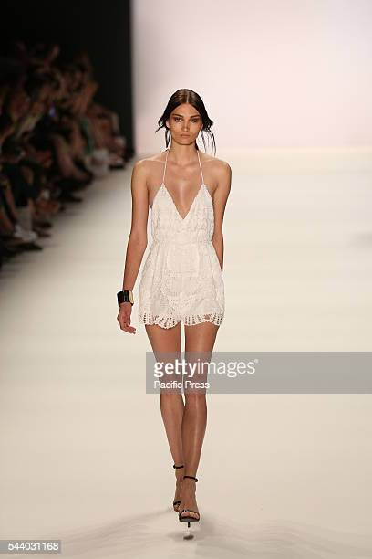 Model wears the collection of Dimitri during the catwalk in the Erika Hess Ice Stadium in BerlinWedding Numerous labels are taking part in the German...