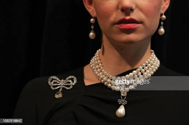 A model wears The 'Queen Marie Antoinette's Pearl' with an estimated value of £767500£1000 GBP on Queen Marie Antoinette's pearl and diamond necklace...