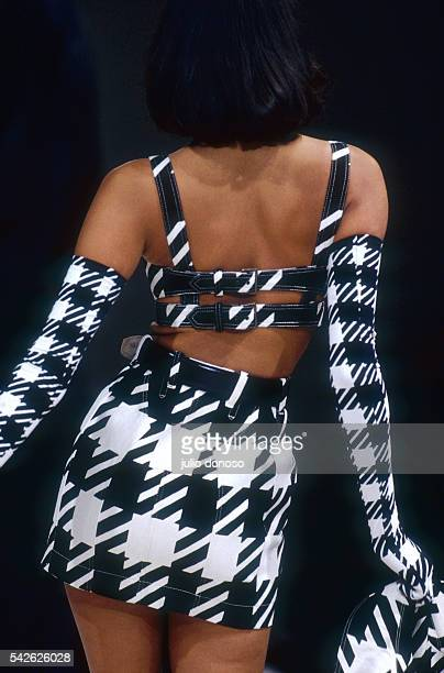 A model wears women's fashion from Azzedine Alaia's 1991 ReadytoWear SpringSummer collection during a fashion show in Paris She wears a blackandwhite...
