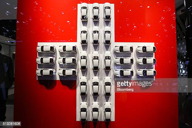 Model white cars sits in a cross formation of the Swiss national flag on the second day of the 86th Geneva International Motor Show in Geneva...