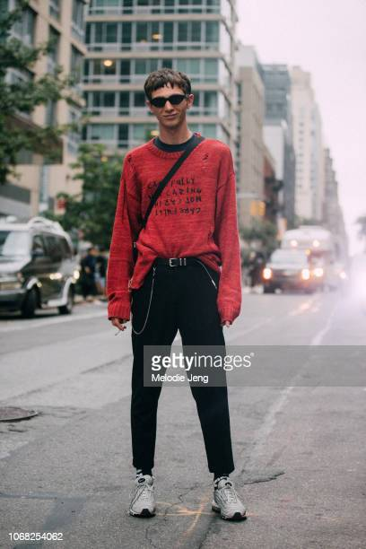 Model Willow Barrett wears a red Ksubi 'Carefully Not Caring' Distressed Sweater and Nike sneakers after the Monse show during New York Fashion Week...