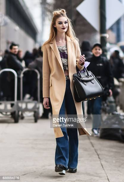 Model Willow Hand is seen wearing a beige coat Anna Sui top and blue jeans outside the Anna Sui show during New York Fashion Week Women's Fall/Winter...