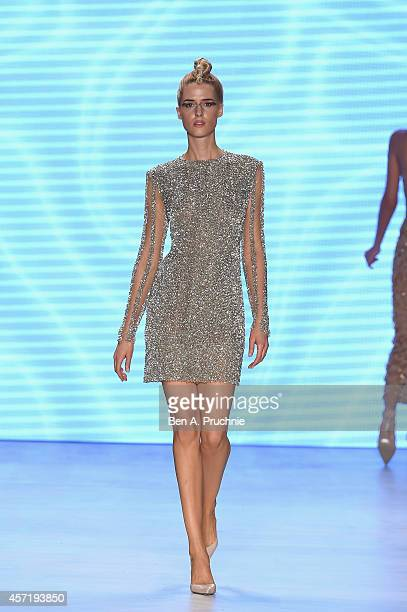 Model Wilma Elles walks the runway at the Red Beard By Tanju Babacan show during Mercedes Benz Fashion Week Istanbul SS15 at Antrepo 3 on October 14...