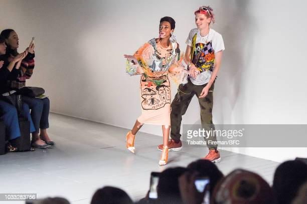 Model Winnie Harlow and designer Matty Bovan on the runway at the finale of her show during London Fashion Week September 2018 at The BFC Show Space...