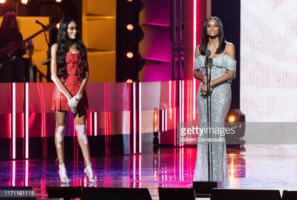 Model Winnie Harlow and singersongwriter and Rock Star Award recipient Ciara speak on stage during the 2019 Black Girls Rock at NJ Performing Arts...