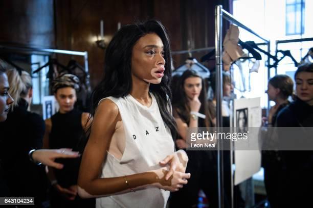 Model Winnie Harlow prepares backstage ahead of a presentation by designer Julien Macdonald during London Fashion Week on February 18 2017 in London...