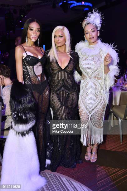 Model Winnie Harlow recording artist Bebe Rexha and recording artist Rita Ora attend the Clive Davis and Recording Academy PreGRAMMY Gala and GRAMMY...