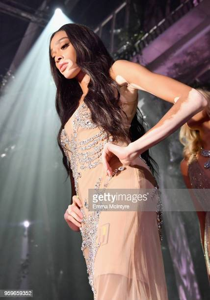 Model Winnie Harlow walks the runway at the amfAR Gala Cannes 2018 at Hotel du CapEdenRoc on May 17 2018 in Cap d'Antibes France