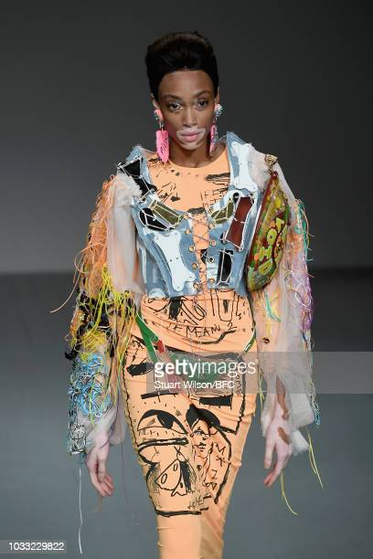 Model Winnie Harlow walks the runway at the Matty Bovan Show during London Fashion Week September 2018 at The BFC Show Space on September 14 2018 in...