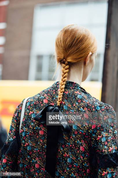 Model with a braided ponytail and bow in the hair after the Erdem show during London Fashion Week September 2019 on September 16, 2019 in London,...