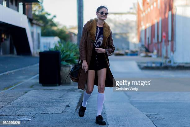 A model with a brown leather coat with fur white long socks and navy shorts at MercedesBenz Fashion Week Resort 17 Collections at Carriageworks on...