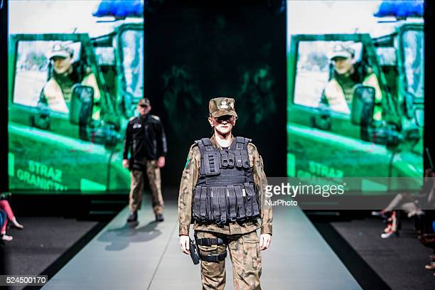 Model with a complet equipment for soldiers in the fashion show uniforms on April 17 2015 in Lodz Poland