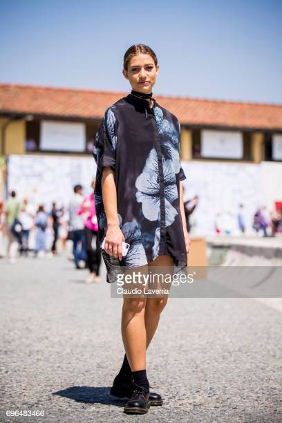 Model with a flower dress is seen during Pitti Immagine Uomo 92 at Fortezza Da Basso on June 15 2017 in Florence Italy