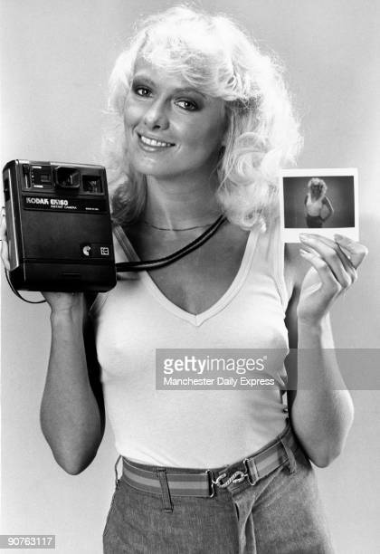 Model with a Kodak polaroid camera