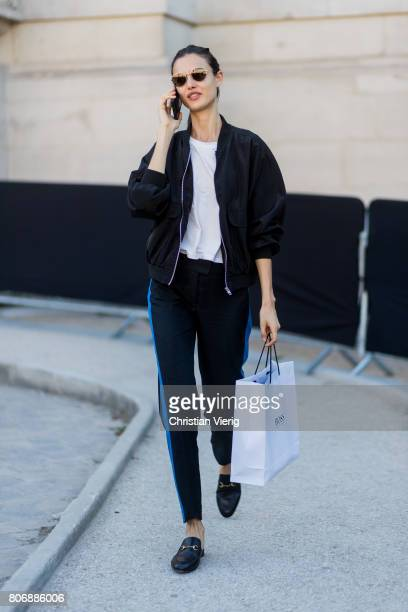 A model with a shopping bag outside Ralph Russo during Paris Fashion Week Haute Couture Fall/Winter 20172018 Day Two on July 3 2017 in Paris France