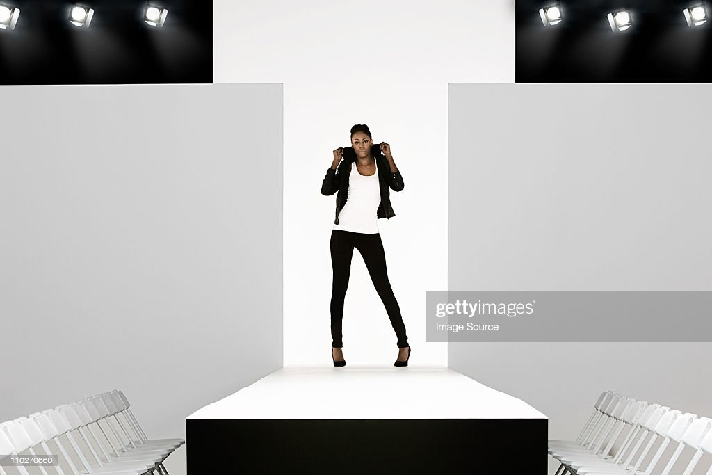 Model with black leather jacket on catwalk at fashion show : Stock Photo