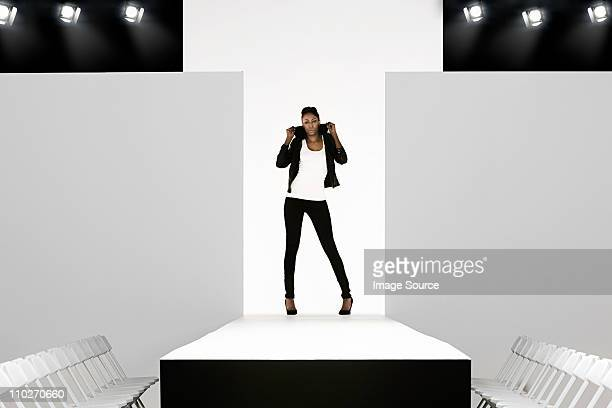 model with black leather jacket on catwalk at fashion show - catwalk stage stock pictures, royalty-free photos & images